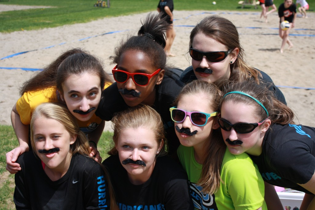 VolleyGirls Fun, Friends. Volleyball. Building Friendships and social skills. Girls at Summer camp having fun with Friends. Goofy masks. Burlington Ontario. Sand Volleyball.
