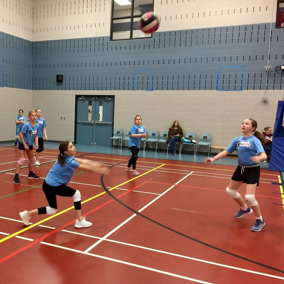VolleyGirls carving time for active play. VolleyGirls volleyball campers learning to play volleyball at Trinity Christian School in Burlington, Ontario